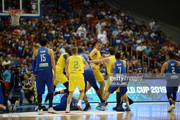 Philippine and Australian players engage in a brawl during their FIBA World Cup Asian qualifier game at the Philippine arena in Bocaue town Bulacan...