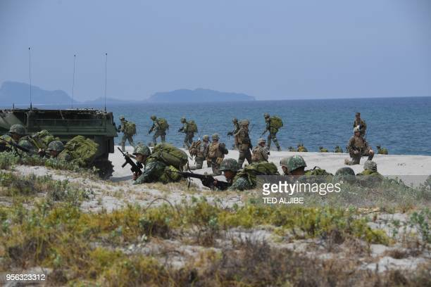 Philippine and US marines simulate an amphibious landing as part of the annual joint military exercise at the beach of Philippine navy's training...