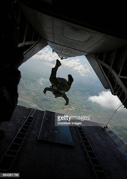 philippine army soldier jumps from a ch-53e super stallion. - military helicopter stock photos and pictures