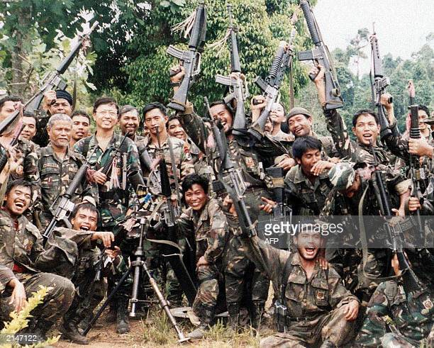 Philippine Army soldiers celebrates at the captured Camp Bilal a sprawling rebel base of the Muslim separates rebels of the Moro Islamic Liberation...