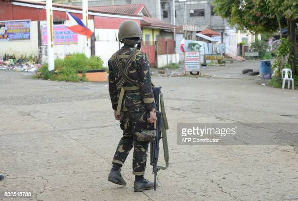 Philippine army trooper stand guard on a deserted street near the front line of the fighting between government troops and Muslim militants in Marawi...