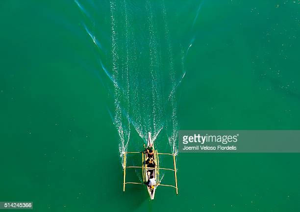 philippine banca or outrigger under san juanico bridge - tacloban stock pictures, royalty-free photos & images