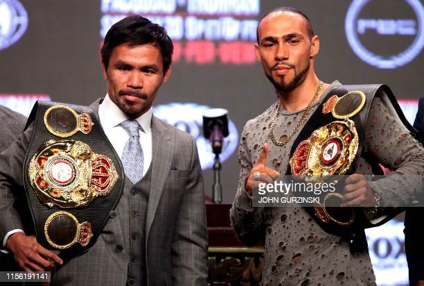Philippine boxer Manny Pacquiao and US boxer Keith Thurman pose as they hold their final press conference at the MGM Grand Hotel & Casino on July 17,...