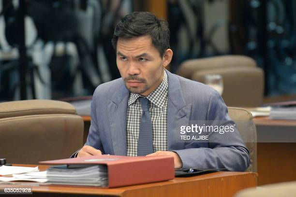 Philippine boxing icon and Senator Manny Pacquiao attends a senate session in Manila on February 13 2017 Pacquiao on February 13 asked his legions of...