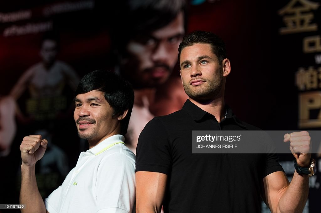 Philippine boxing icon Manny Pacquiao (L) and Chris Algieri (R) of the US pose during a pre-fight press conference in Shanghai on August 26, 2014. Pacquiao will take on Algieri in a World Boxing Organization (WBO) welterweight title fight in Macau on November 23.