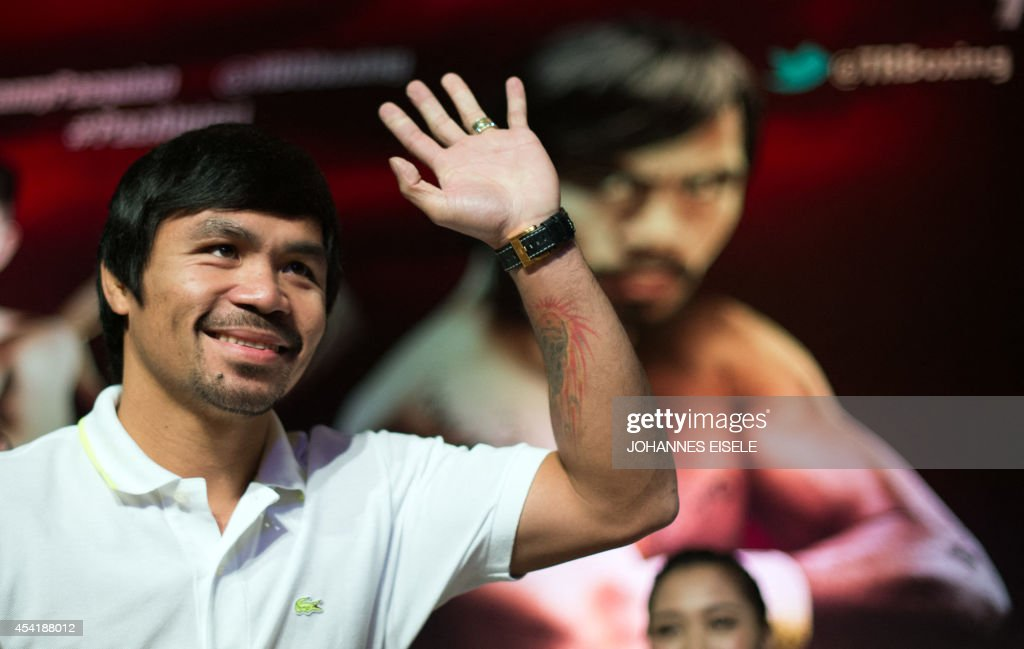 Philippine boxing icon Manny Pacquiao gestures during a pre-fight press conference in in Shanghai on August 26, 2014. Pacquiao will take on Chris Algieri of the US in a World Boxing Organization (WBO) welterweight title fight in Macau on November 23.
