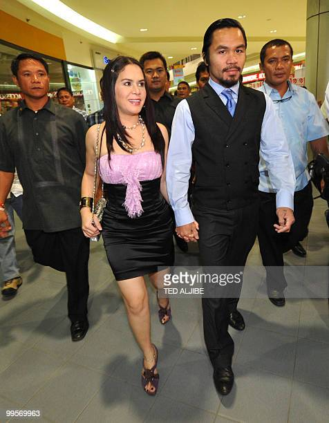 Philippine boxing superstar Manny Pacquiao and his wife Jinkee arrive for his victory party after winning a seat in the parliament and to celebrate...