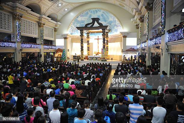 Philippine devotees of the Roman Catholic Church attend the first of nine dawn masses signalling the official start of the Christmas season in...