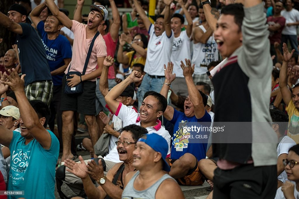 philippine fans cheer as they watch a broadcast of the fight in the