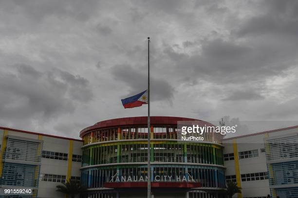 A Philippine flag at half mast is seen at the city hall grounds where Tanauan Mayor Antonio Halili was assassinated by a suspected gunman while...