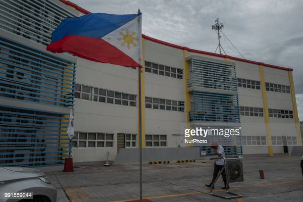 A Philippine flag is seen at the parking lot where Tanauan Mayor Antonio Halili was assassinated by a suspected gunman while taking part in a flag...