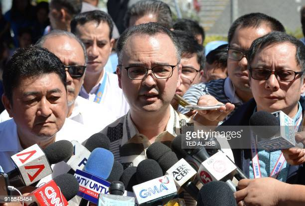 Philippine Foreign Secretary Alan Peter Cayetano speaks to reporters after viewing a wooden casket containing the body of Filipina overseas worker...