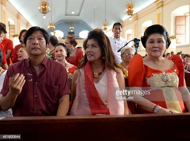 Philippine former first lady and now congresswoman Imelda Marcos sits with her daughter governor Imee and Ferdinand Marcos Jr as they attend mass to...