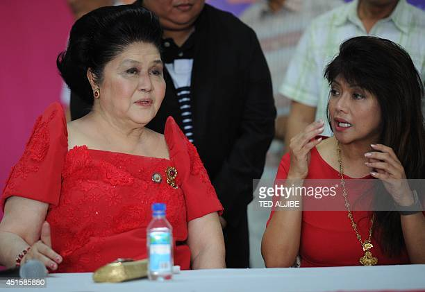 Philippine former first lady and now congresswoman Imelda Marcos talks to her daughter governor Imee during a medical mission as part of her 85th...