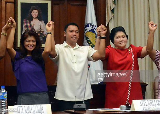 Philippine former first lady Imelda Marcos and her daughter Imee Marcos gesture as they are proclaimed winners in the just concluded midterm...