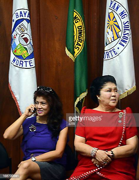 Philippine former first lady Imelda Marcos and her daughter Imee Marcos wait to be proclaimed as reelection winners in the just concluded midterm...