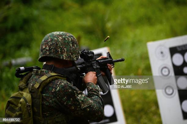 A Philippine Marine fires his rifle during a demonstration at Military Operation Urbanized Terrain training exercises at the marine base in Ternate...