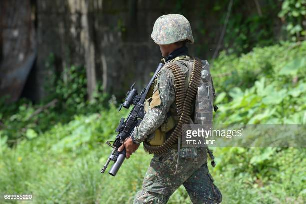 A Philippine marine patrols a deserted street in Marawi on the southern island of Mindanao on May 30 2017 Philippine authorities on May 30 warned...