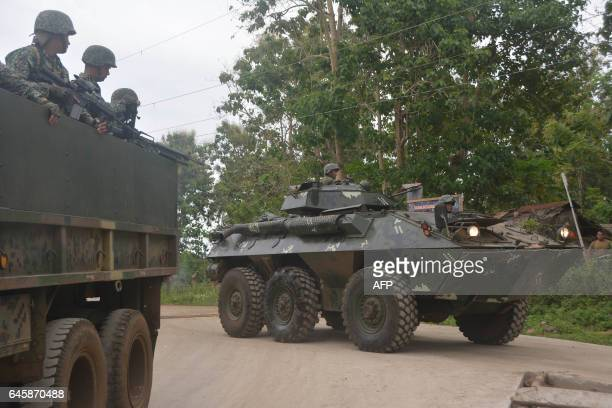 Philippine marines aboard an Amored Personnel Carrier and a truck guard a highway in Indanan town Sulu province on the southern island of Mindanao on...