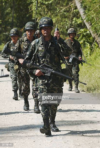 Philippine marines from the 3rd Battalion resume patrols around a former Moro Islamic Liberation Front stronghold on March 31, 2004 near Pikit on the...