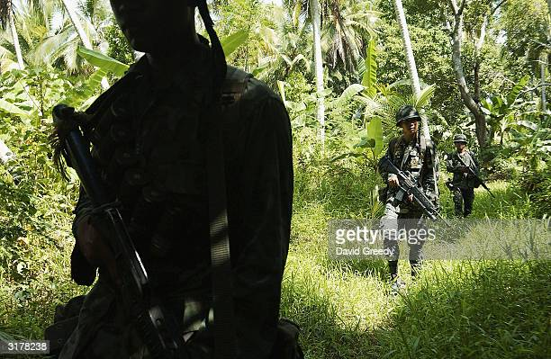 Philippine marines from the 3rd Battalion resume patrols around a former Moro Islamic Liberation Front stronghold on March 31 2004 near Pikit on the...