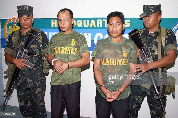 Philippine Marines hold two suspected suspected members of Abu Sayyaf terrorist group Nasser Hapilon and Hamid Abdul Baser 02 April 2004 at the...