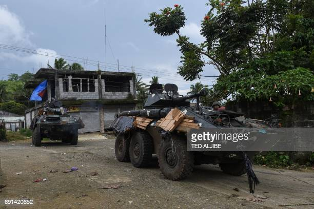 Philippine marines inside V300 light wheeled armoured vehicles arrive after engaging Islamist militants at in Marawi on the southern island of...