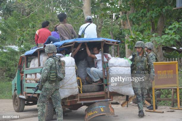 Philippine marines inspect a passenger jeepney at a military check point along a highway in Indanan town Sulu province in southern island of Mindanao...