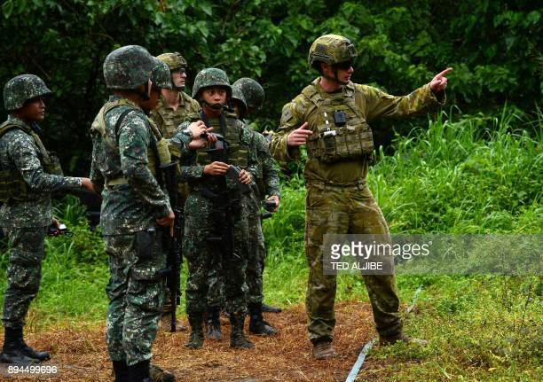 Philippine Marines listen while an Australian soldier gives instruction during a demonstration at Military Operation Urbanized Terrain training...
