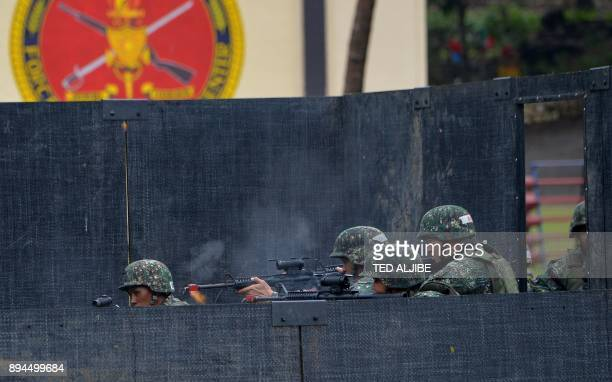 Philippine Marines maneuover in a mock building during a demonstration at Military Operation Urbanized Terrain training exercises with Australian...