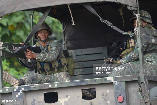 Philippine marines patrol a deserted street in Marawi on the southern island of Mindanao on May 30 2017 Philippine authorities on May 30 warned...