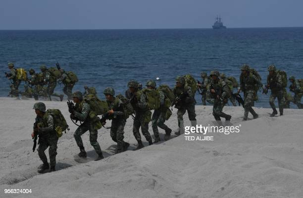 Philippine marines take position as navy's frigate Alcaraz standsby during the amphibious landing as part of the annual Philippines and US joint...