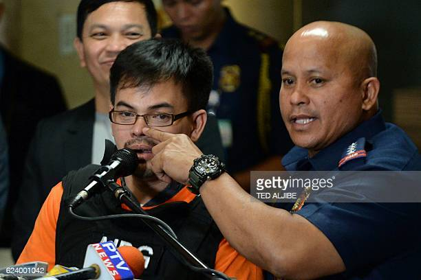 Philippine National Police chief Director General Ronald dela Rosa points to the nose of Kerwin Espinosa son of the late mayor Rolando Espinosa as he...