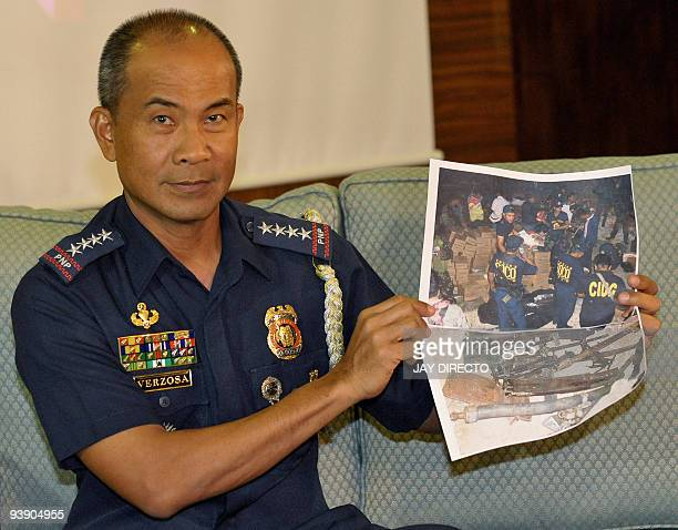Philippine National Police Chief Jesus Verzosa holds a photo of operations conducted in Shariff Aguak Maguindanao southern Philippines following the...