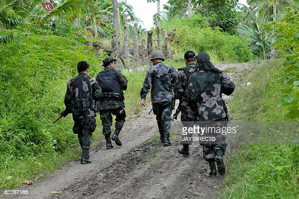 Philippine national police commandos patrol the remote village of Takepan in North Cotabato Province of the southern Philippines on August 12 2008...