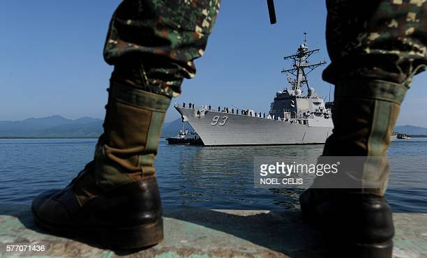 A Philippine naval officer stands guard during the arrival of missile destroyer USS Chung Hoon before the USPhilippine joint naval military exercise...