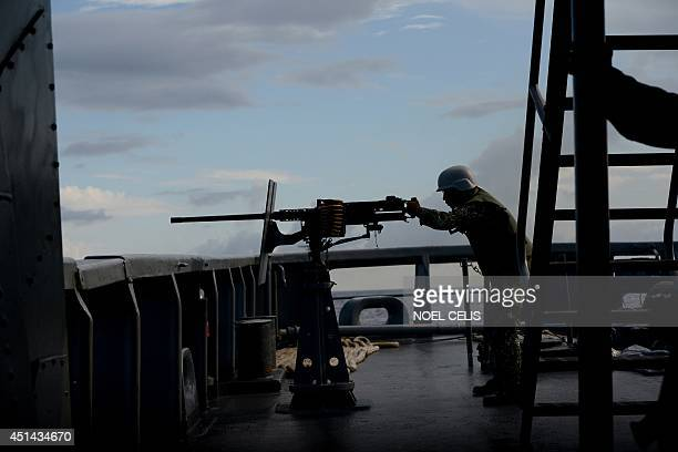 A Philippine Navy personnel mans a 50 caliber machine gun during the bilateral maritime exercise between the Philippine Navy and US Navy dubbed as...