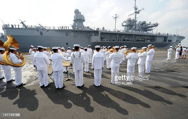 Philippine Navy personnel welcome the USS BlueRidge at it prepares to dock at the international port in Manila on March 23 for a fourday visit The...