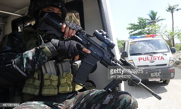 Philippine Police Commandos take part in an exercise in Manila on November 14 ahead of the Asia-Pacific Economic Cooperation summit. The Philippines...