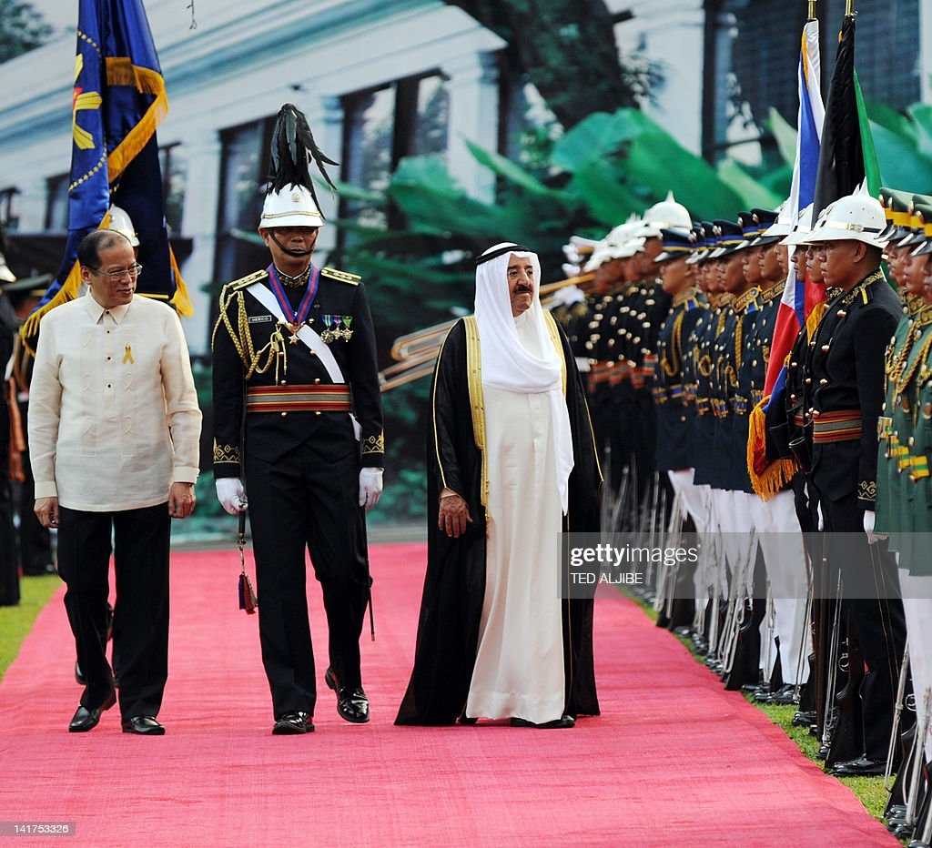 Philippine President Benigno Aquino (L) and Sheik Sabah Al Ahmad Al Jaber Al Sabah (R), Amir of Kuwait pay respect to the flags of their respective countries during a welcoming ceremony at Malacanang Palace grounds in Manila on March 23, 2012. Sheik Sabah Al Ahmad Al Jaber Al Sabah is here for a four-day visit.