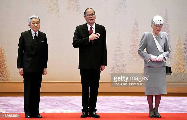 Philippine President Benigno Aquino Emperor Akihito and Empress Michiko attend the welcome ceremony at the Imperial Palace on June 3 2015 in Tokyo...
