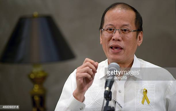 Philippine President Benigno Aquino gestures as he speaks to reporters on the sidelines of an AsiaEurope meeting in Manila on June 5 2014 Aquino...