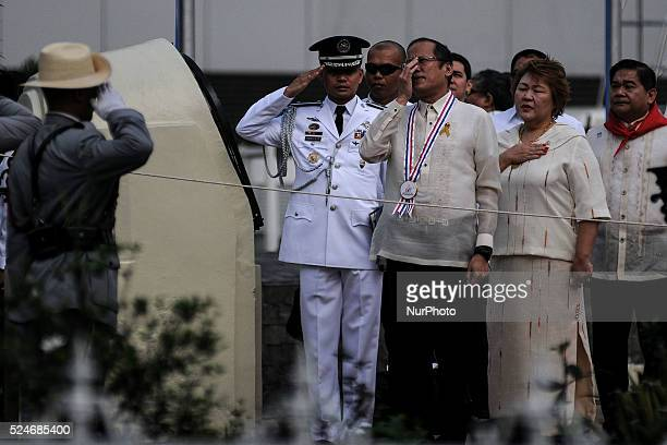 Philippine President Benigno Aquino III adjusts his glasses during the singing of the national anthem at the Bonifacio Monument Circle in Caloocan...