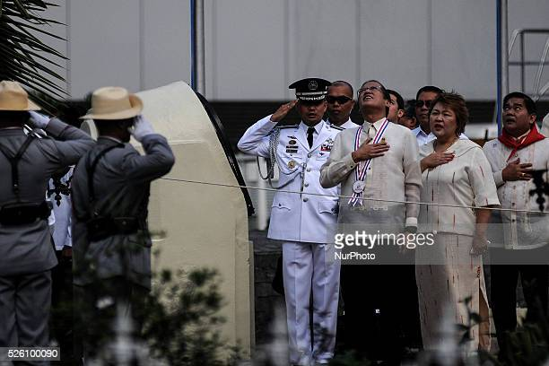 Philippine President Benigno Aquino III observes the singing of the national anthem at the Bonifacio Monument Circle in Caloocan city Metro Manila...