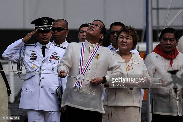 Philippine President Benigno Aquino III pulls the rope during a flag raising ceremony at the Bonifacio Monument Circle in Caloocan city Metro Manila...