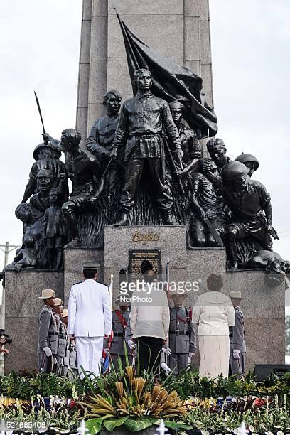 Philippine President Benigno Aquino III stands in front of the monument of Filipino nationalist Andres Bonifacio in Caloocan city Metro Manila...