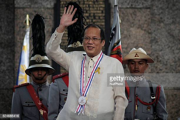 Philippine President Benigno Aquino III waves to the crowd during a ceremony marking Filipino nationalist Andres Bonifacio's 150th birth anniversary...
