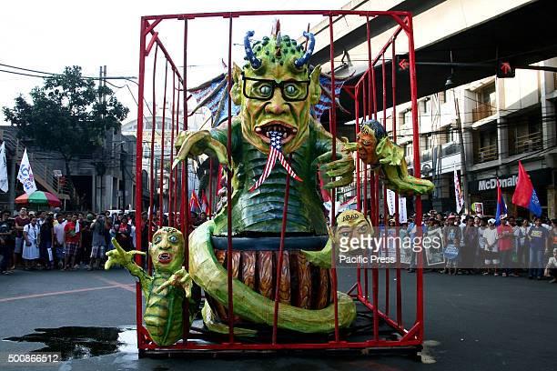 Philippine president Benigno Aquino III's effigy at the Mendiola Bridge in Manila Militant group Bayan Muna lead a protest march to commemorate the...