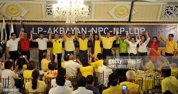 Philippine President Benigno Aquino links hands with the administration's senatorial lineup for the 2013 polls Senator Antonio Trillanes Senator...