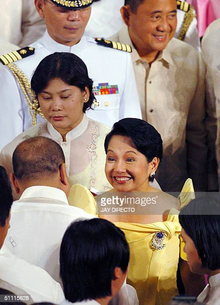 Philippine President Gloria Arroyo greets members of Congress after delivering her stateofthenation address before a joint session of Congress in the...
